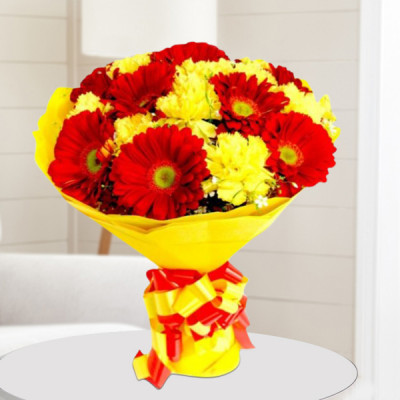 Red and Yellow Flower in Yellow Paper Paking